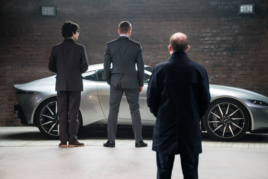 (l to r) Q (Ben Whishaw), Bond (Daniel Craig) and Tanner (Rory Kinnear) look at the Aston DB10 in Q's workshop in Metro-Goldwyn-Mayer Pictures/Columbia Pictures/EON Productions' action adventure SPECTRE.